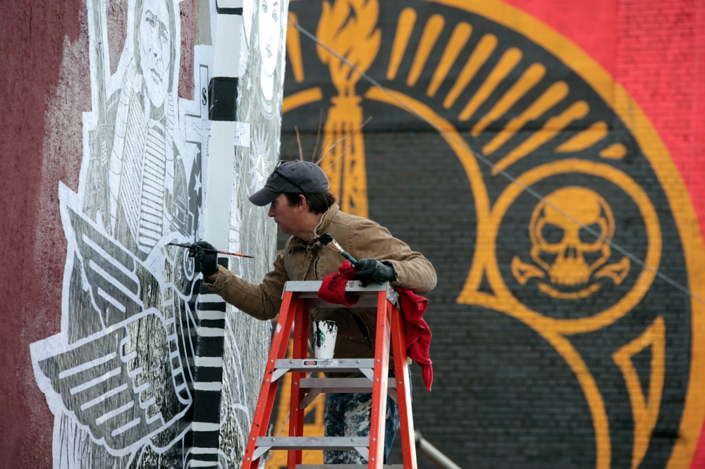 Artist Dylan Egon works on an art piece in Jersey City.