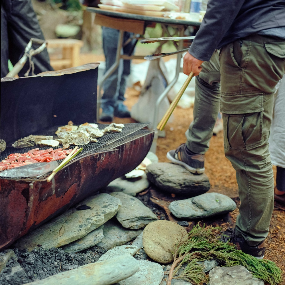 Kameyama Sensei cooks food for his staff and volunteers during the construction of Hamagurihama's campsites.