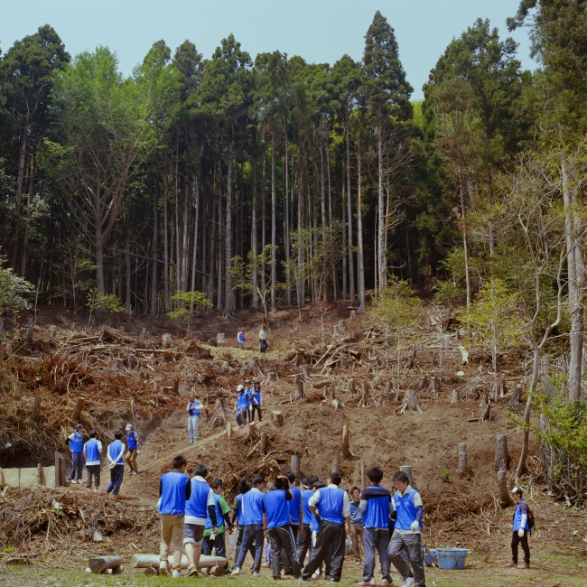 A group of volunteer workers help the Hamagurihama staff clear old tsunami debri from the village.