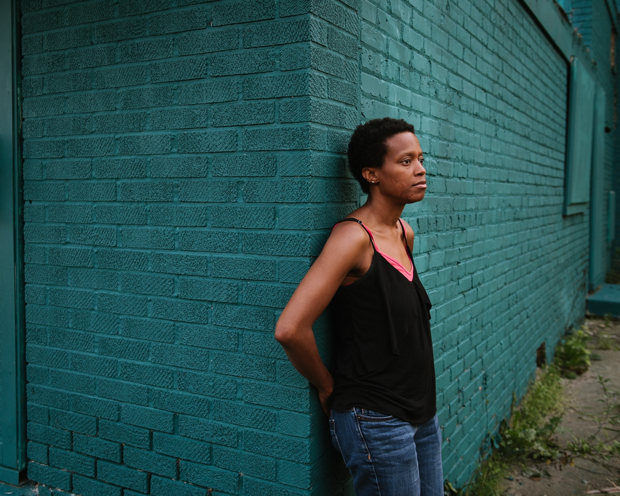 Amanda Williams is a Chicago-based artist who explores cultural identity and the politics of race and urban space through her collaborative projects, public installations, painting, and photography. I photographed her in South Side, Chicago, with a house she painted and named Newport 100s . She's been taking abandoned houses on vacant lots and sheathed them in solid colors reminiscent of the black experience in what remains a fragmented city.