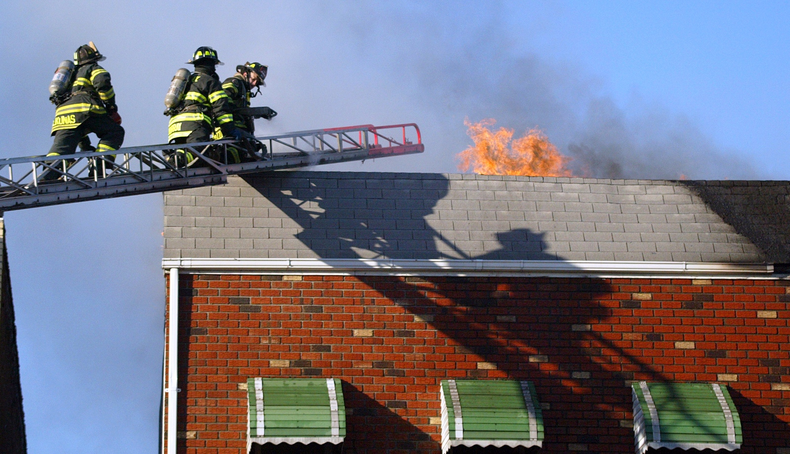 Firefighters work on a house fire in Brooklyn.