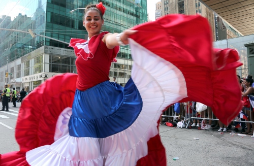 The Dominican Republic pride was on full display Sunday as the borough of Manhattan played host to the annual Dominican Day Parade. Thousands of parade-goers lined up along Sixth Avenue to watch the festivities adorned with the island's red, white and blue flag. A dancer entertains the crowds wearing the Dominican flag colors.