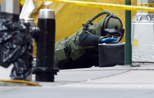 An NYPD Bomb Squad Technician check a suspicious bag in Midtown Manhattan.