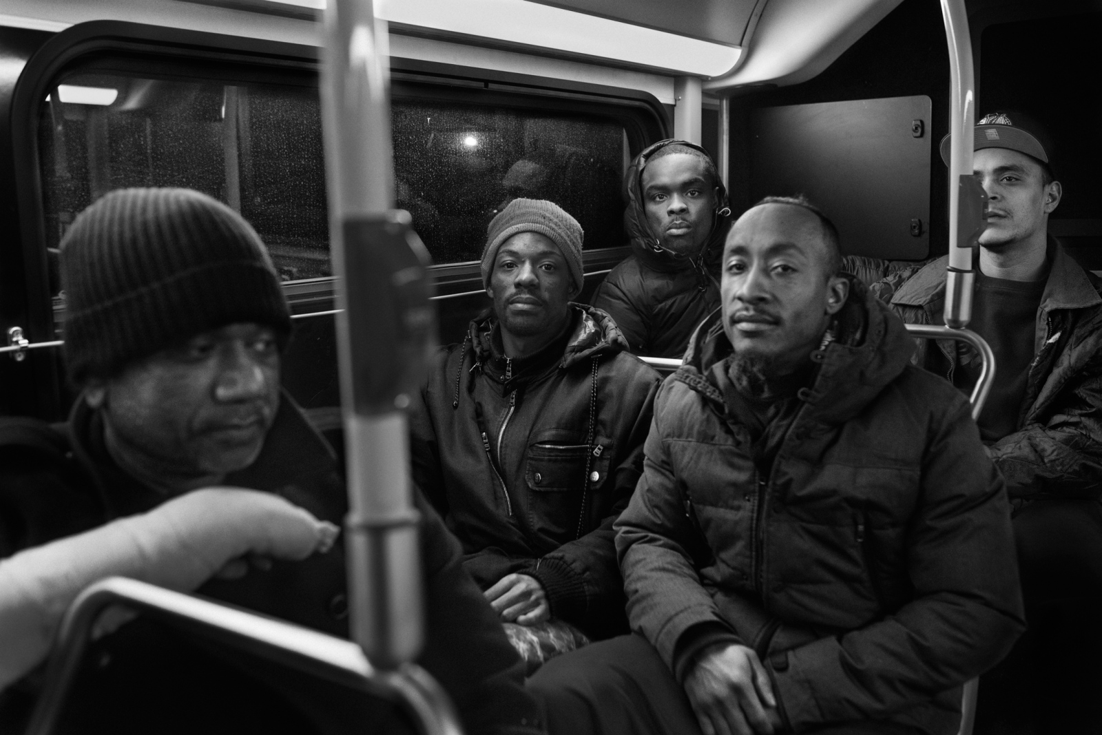 Around 80% of Rikers population has not being convicted or proved guilty but as they can not afford to post they have to remain in jail while awaiting trial. Five formerly incarcerated men ride the Q100 bus after being released from Rikers Island.  All of them were released after posting bail.  From left to right Mohamed Ali Sha, 43, Rando Arison, 29, Kern Isaac, 21, Alfredo Gonzales, 36, and Luis Marino, 33. February 13th, 2016.