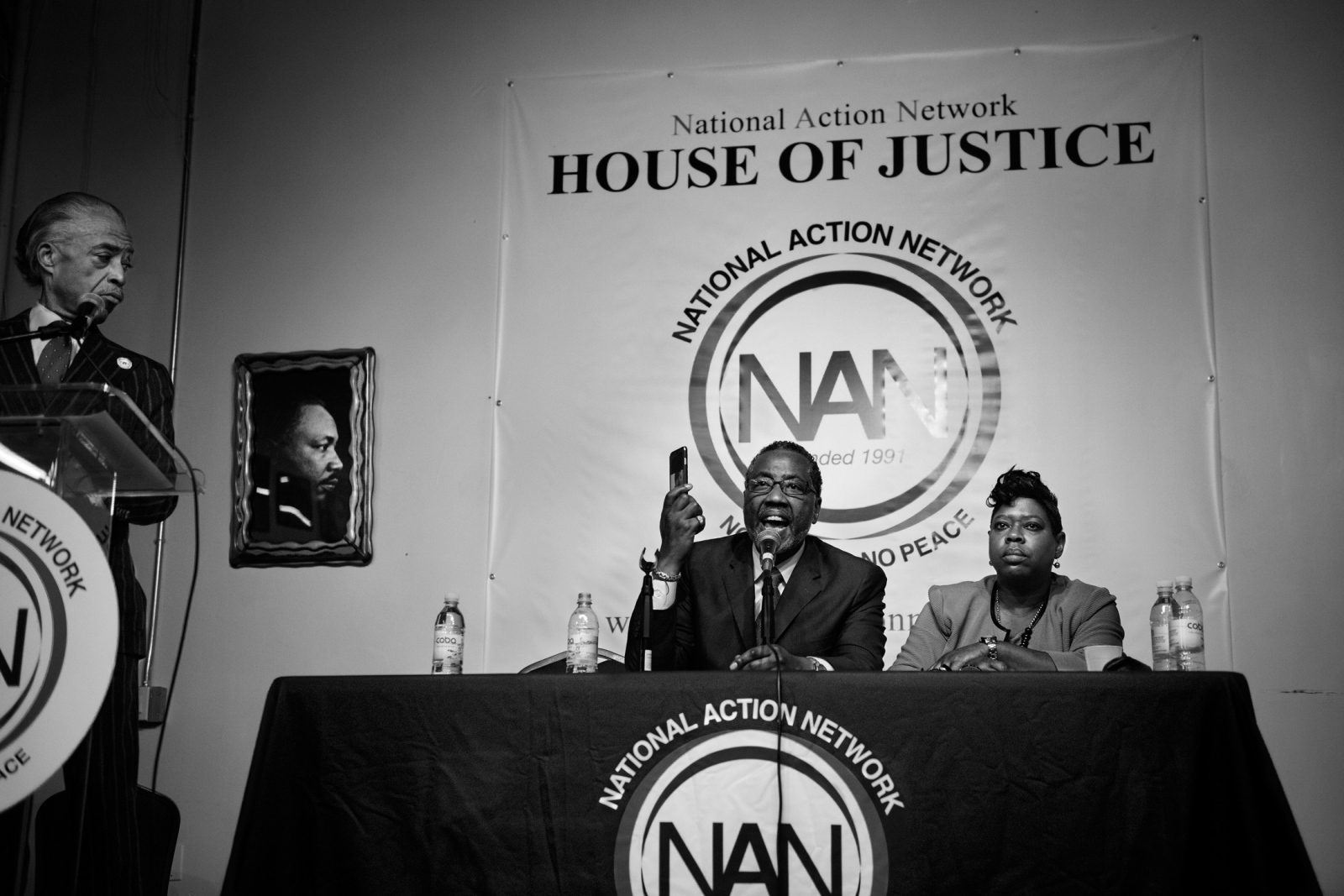 An emergency community meeting on the future of Rikers Island is hold on The House of Justice inWest Harlem. Norman Seabrook, former head of the correctional officers benevolent association, shows a picture of aninmate who was stabbed the night before by another inmate. He was later indicted by the FBI for corruption charges.Reverend Al Sharpton, a key civil rights activist and the recently appointed Bronx District Attorney Dercel Clark were alsopart of the debate.February 22nd, 2016.