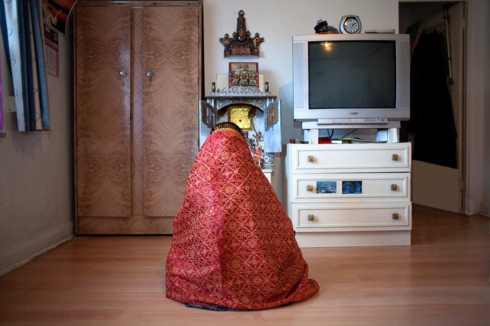 Wembley, UK, October 6, 2012: Shanta Ben Makwana, 63, prays at a tiny temple inside her apartment.