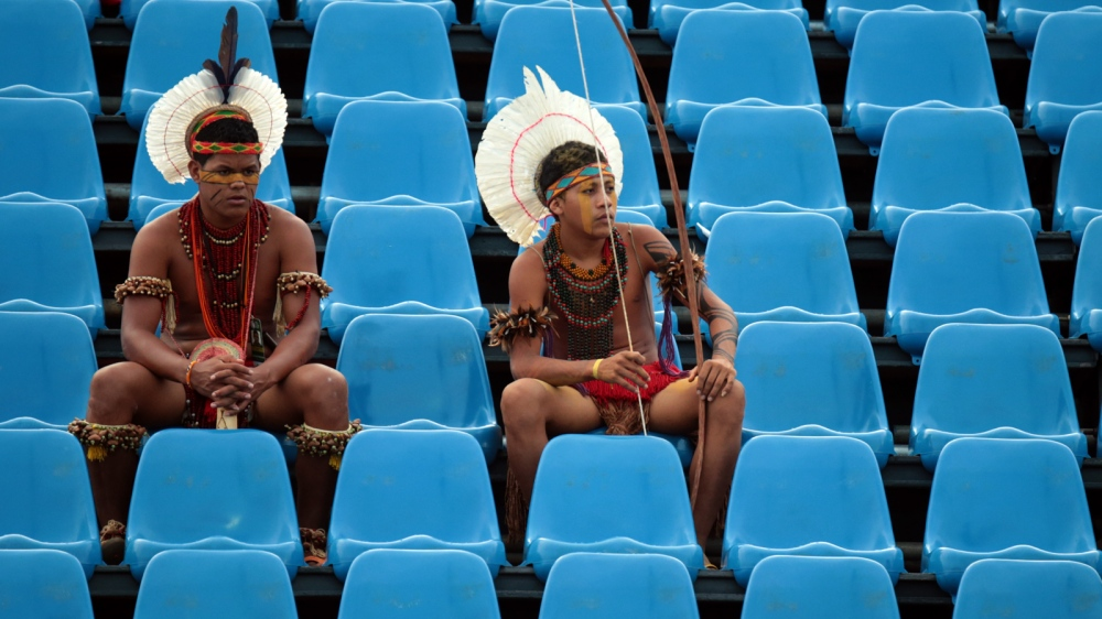 Paxató warriors are seen in the stands during the games.