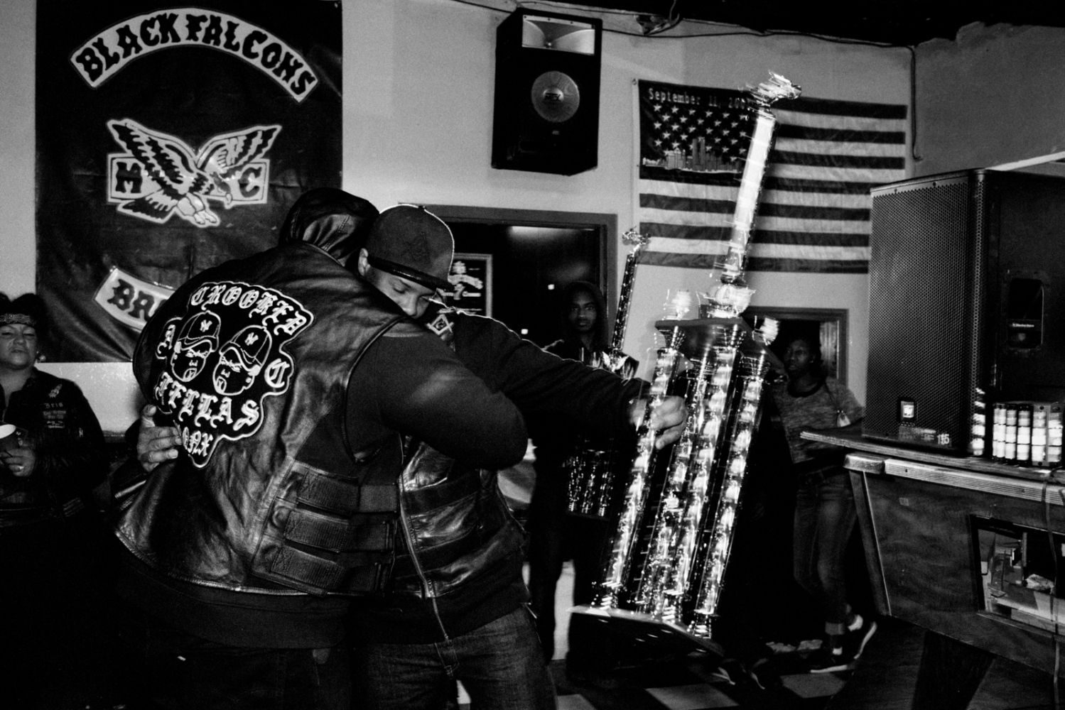 President Choice awards a trophy to a member of Crooked Fellas AC (automotive club) at the Black Falcons MC trophy party, The Bronx, 2016