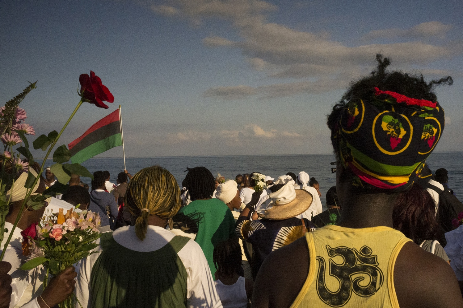 "The Tribute to our Ancestors of the Middle Passage has a political as well as spiritual meaning. The red, black and green  Pan-African flag is a regular sight at the ceremonies. Although there is no universal definition of Pan-Africanism, its adherants typically believe that all Africans and their descendants in the Americas belong to a single ""race"" that shares, or should share, a broad cultural unity. They are devoted to recovering or preserving African traditions and teaching about the contributions of Africans and those in the diaspora to the modern world."