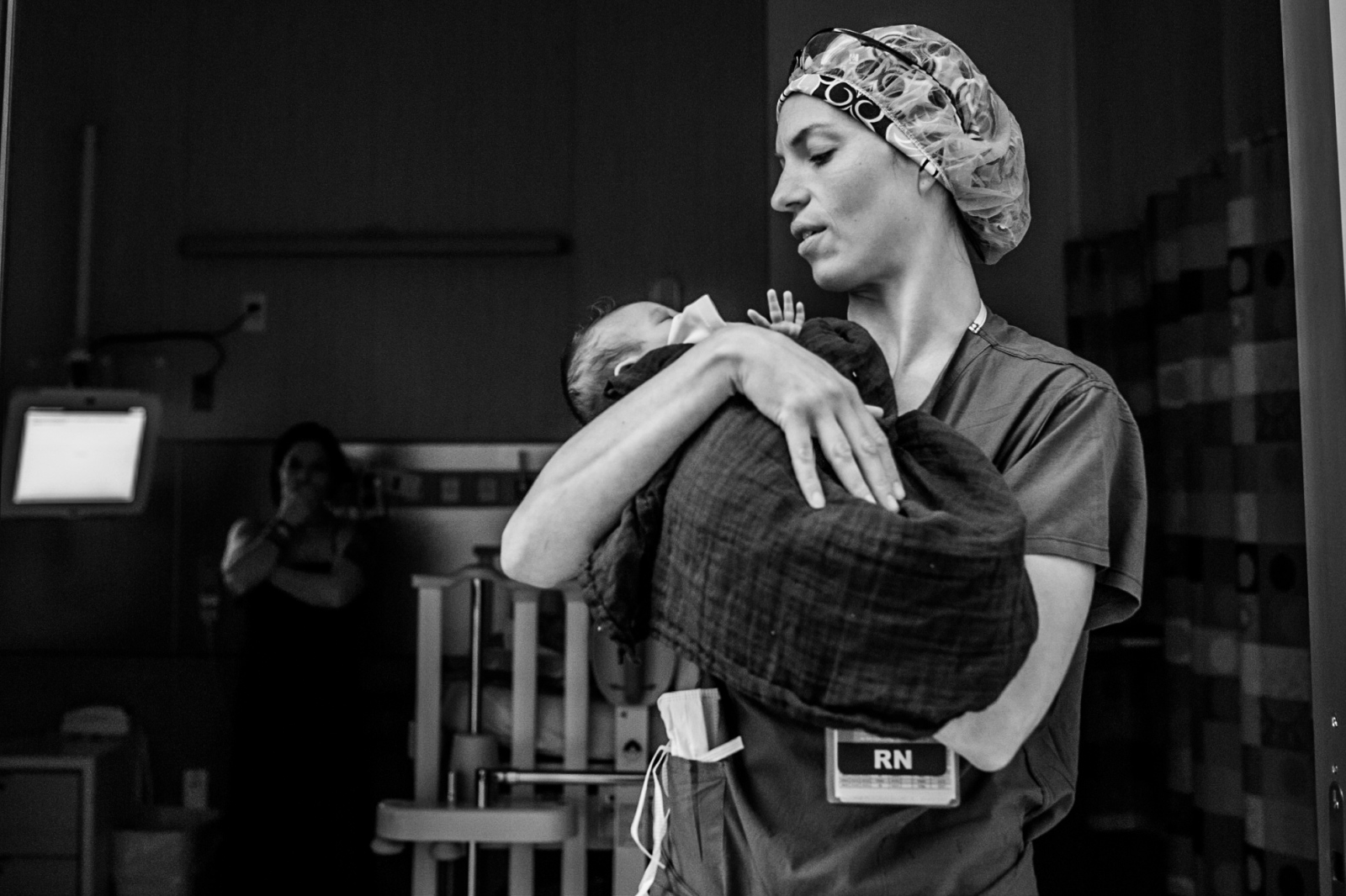 An OR nurse carries Sky to surgery at Randall Children's Hospital.
