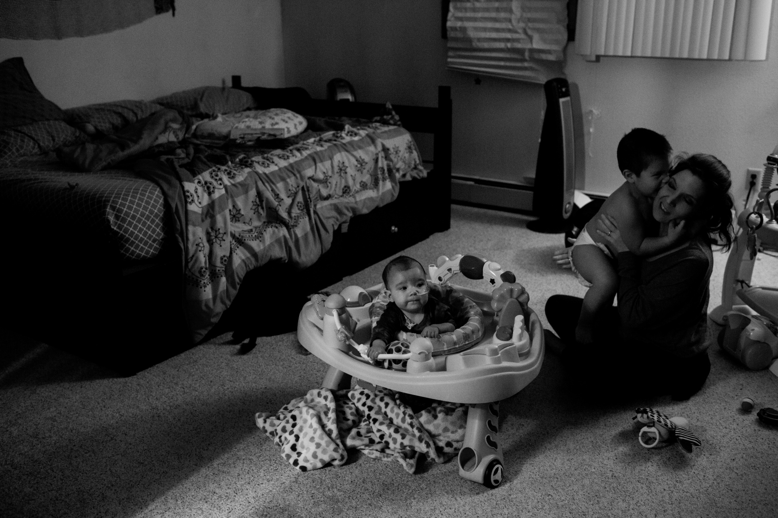 Sage, 2, Jen, and Sky, play in their bedroom in Eagle River, Alaska.