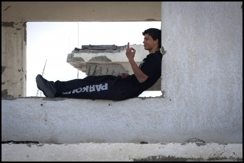 18 year old Fahed Dawood offers an opinion on his fellow team members criticism of him having to take a rest. Beit Hanoun, Northern Gaza Strip.