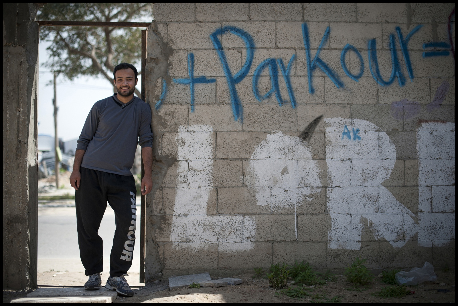 "25  year old Muhammad Lubbad manager and founder of '3 Run Gaza' at the groups practice centre in Beit Hanoun, Northern Gaza Strip: "" My background is in gymnastics but i saw parkour while i was 'online' so i became interested and established the club.'"