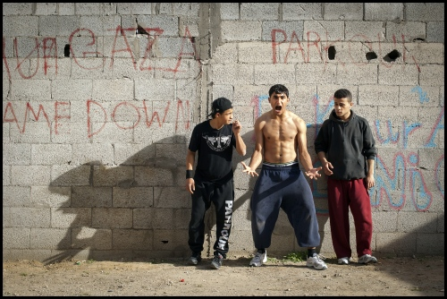 """19 year old Hamza Chalan gets himself psyched up for a jump at parkour Team '3 Run Gaza' home base just off Saladin Road n Beit Hanoun, Gaza Strip. hamza has lost two of his brothers to hostilities within the Gaza Strip. One brother in 2008 and the other in 2011: """"In Gaza the situation we have is very bad. i like to be a role model for younger children and in some way through seeing my Parkour make them happy.'"""