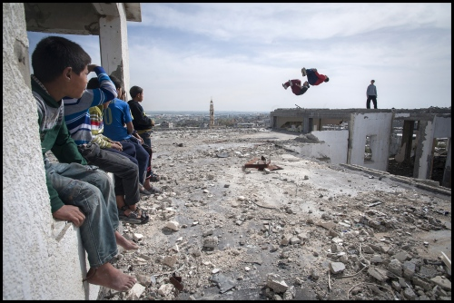 '3 Run Gaza' at the bombed out remains of a flat complex destroyed in 2014 during Israel's 'Operation Protective edge', Beit hanoun, Northern Gaza Strip.