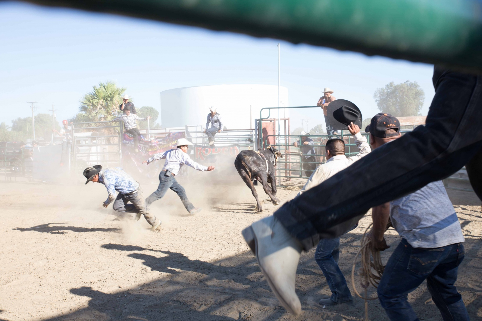 Men run from a loose bull during a rodeo in Huron, California. Drought has taken its toll on towns in the westside of the Central Valley and Huron has seen its population dwindle as farmworkers move to other cities and states where there is more work. July 2016.