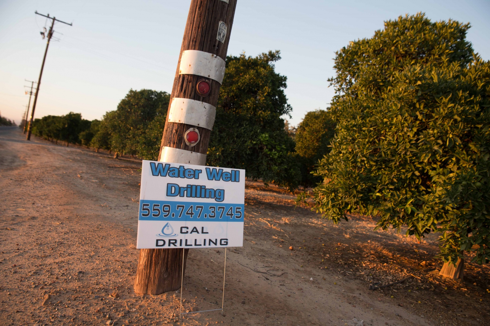 Signs that advertise companies that drill water wells are scattered throughout towns and fields in the Central Valley. Over 5,000 new wells have been drilled in Tulare County - the epicenter for the drought - this past year, but at the same time about 2,000 wells have failed. June 2016.