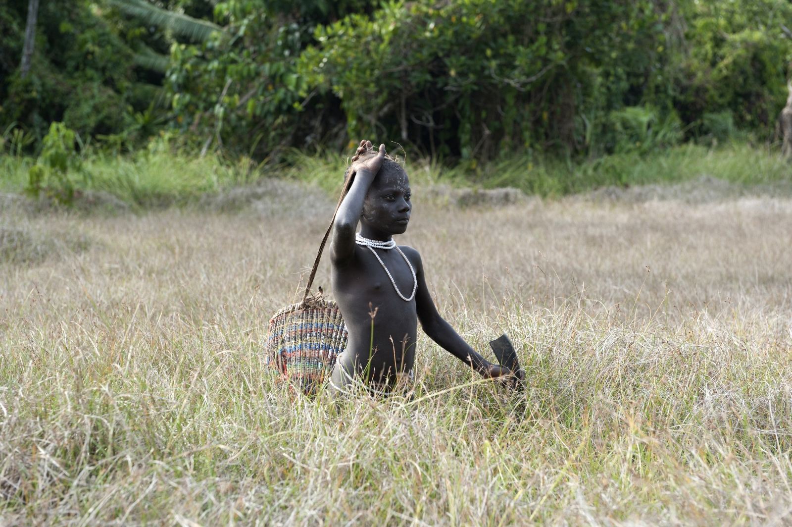 Art and Documentary Photography - Loading jarawa_beilvert_girl_bursting_from_tall_grass.jpg