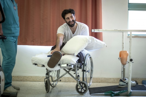 "29 year old Syrian Law Student Moayed Srour undergoing Physiotherapy at MSF's Hopsital for Reconstructive Surgery in Amman, Jordan. Moayed was wounded in both legs from a tank shell in the strategically important city of Al-Shaykh Maskin in the Daraa region of Syria in december 2014. He lost his left leg below the knee and his right leg underwent surgery with an orthopedic implant used to support the bone's while healing. Moayed:""I can no longer remember how many operations i've had so far. Physio says i will need at least another 4 years of therapy and operations to regain my walking with the aid of the prosthesis.  'It would of taken me forever to recover if it hadn't been for the hospital here.'"