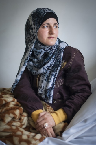35 year old Syrian refugee Saha from Aleppo. Saha was injured in the leg and hand from a blast from an artillery shell while sheltering in a suburb of Aleppo in 2012. Luckily she survived as the woman sheltering next to her was killed by the same explosion.  Saha has had 19 operations so far to save and then correct her injury to her leg and hand. She has been plagued by some infections and inadequate surgical procedures with some of the previous hospitals she has attended. Now with MSF her treatment will be free.