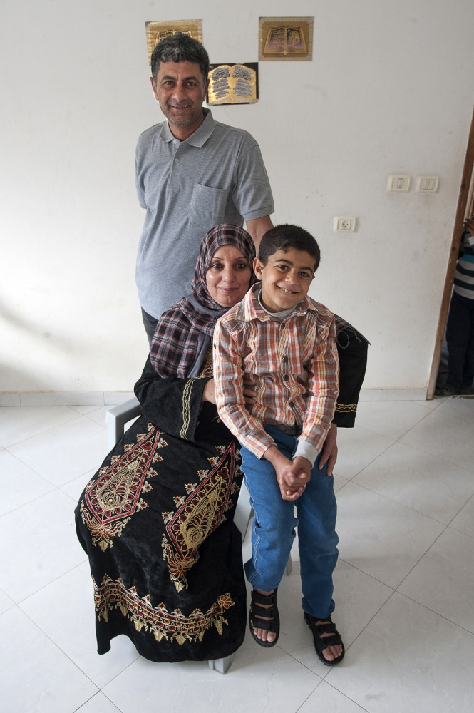 Abdel Motalib Awad at home with his parents. One year on from his Kidney Transplant.