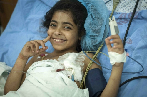 9 year old Fatma Othman several days after her successful kidney transplant operation recuperates in a ward at the Al Shifa Hospital, Gaza City, occupied Palestinian territory.