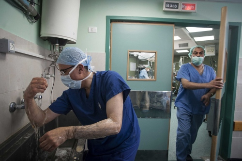 Dr Abdul Hammad scrubs up prior to entering surgery at the Al Shifa Hospital, Gaza.