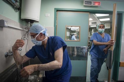 Dr Abdul Hammad scrubs up prior to entering surgery at the Al Shifa Hospital, Gaza.