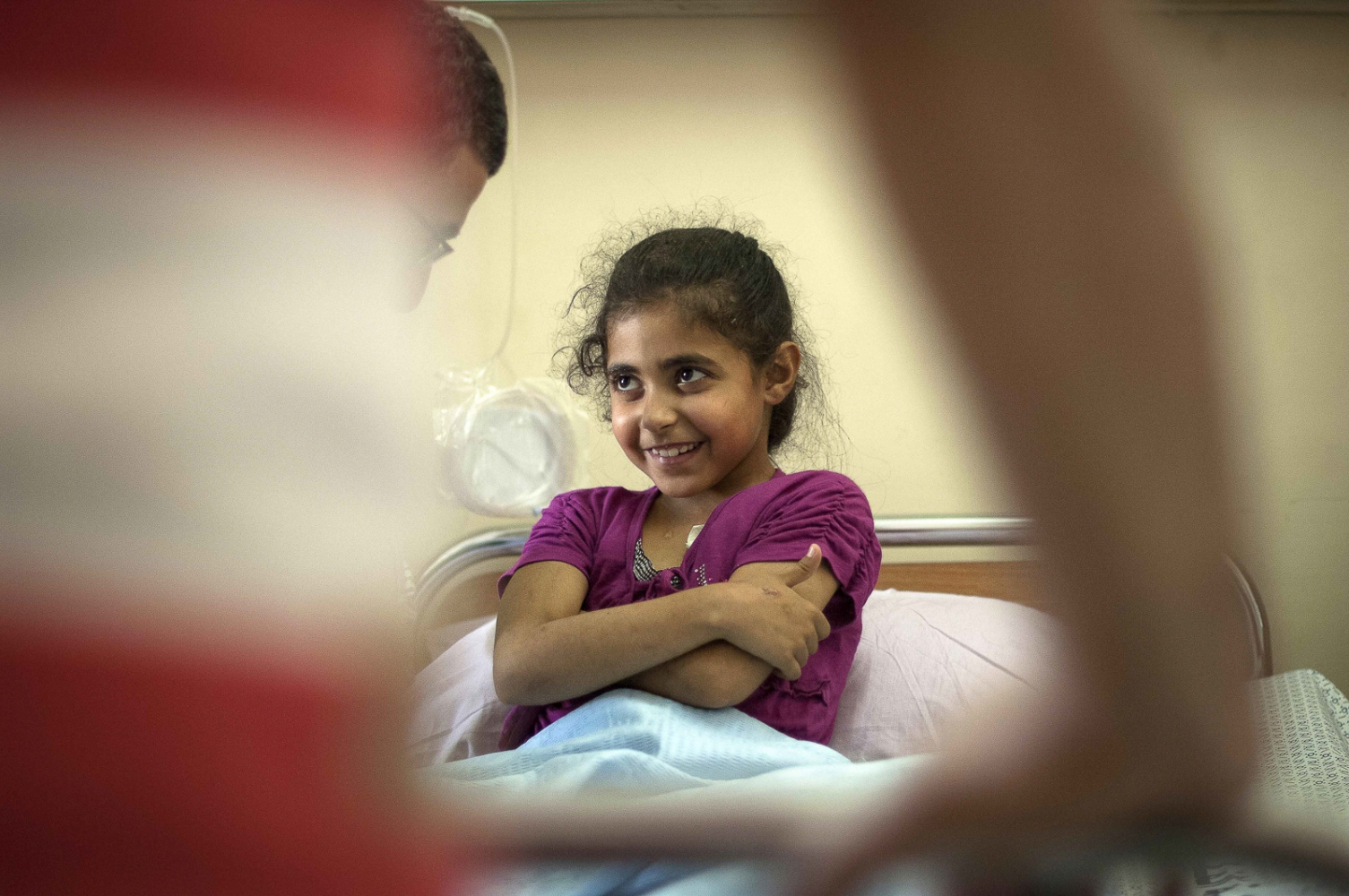 9 year old Fatma Othman meets the surgical team from The Royal Liverpool University Hospital for the first time prior to her kidney transplant operation the following day. Her mother Marwa is donating her kidney to her daughter. At the Al Shifa Hospital in Gaza City, occupied Palestinian territory.