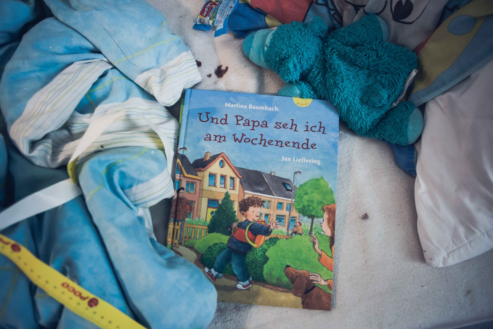 "Claudia B. 37, uses this children's book to explain his father's abscence to her son Oskar, 3: ""Und Papa seh ich am Wochenende"" (engl: ""And I see daddy on weekends"". Berlin, GERMANY, July 7, 2016."
