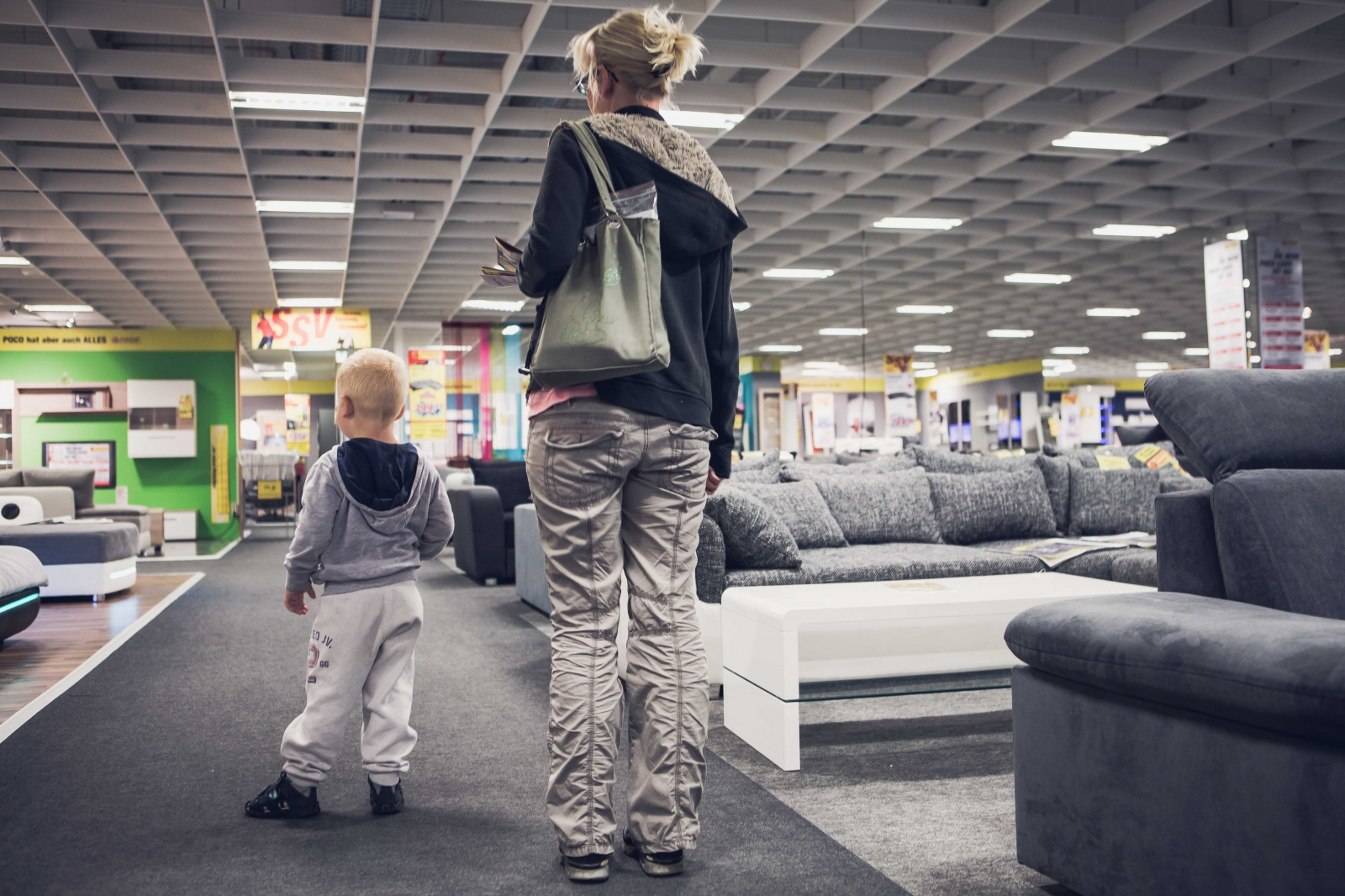 Claudia B, 37, and her son Oskar, 3, go shopping for furniture for their new apartment. After only three months in the safe house and several rejections from landlords that stigmatize women with her social background, Claudia was lucky to find a new home for her family.