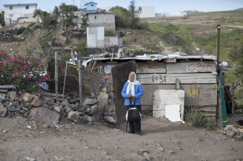 Alejandra Fuentes, 79, stands outside her humble residence in Rosarito.