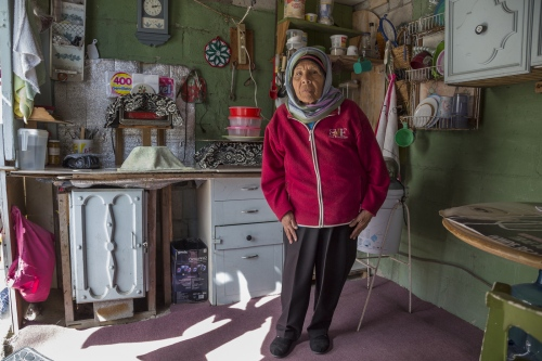 Juana Reza poses for a portrait at her friend and neighbor Irma Morales' house, who introduced her to Islam.