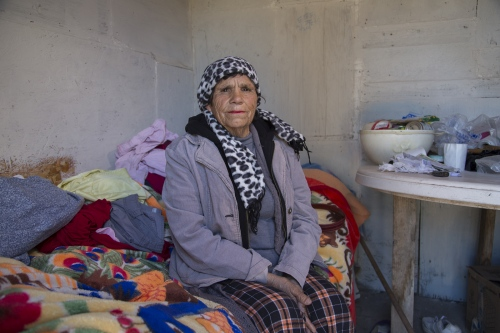 Maria de Lourdes Esquer, who turned 70 years old last month, at her bedroom that she rents for 600 pesos a month, roughly 35 dollars.