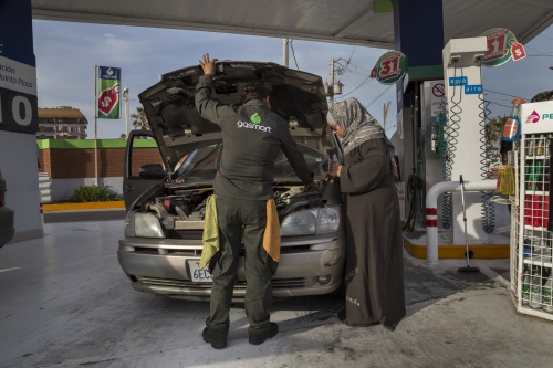 Fatima Castañeda gets a service inspection at a gas station in Rosarito, Mexico.