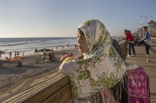 Fernanda Galaviz looks at the ocean in Playas de Tijuana, Mexico, before going to the mosque with her mom and little sister.