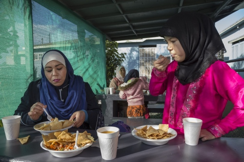 Muslim convert Fatima Castañeda and her daughter Naomi, 10, have lunch at the musalla after Jumma, which is Fridays' religious service.