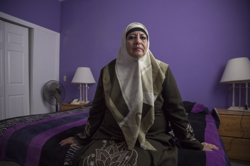 Maryam Alvarez poses for a portrait in the bedroom of her house in Rosarito, Mexico. Alvarez, along with her friend Amina Rivera, were Muslim pioneers in the region. In 2008, they began practicing in Alvarez's living room, because there was no mosque or musalla at the time.