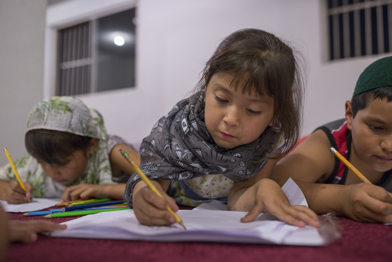 Michelle Garaviz and her sister Fernanda and some other kids draw and play at the Masjid Omar, in Playas de Tijuana, Mexico.