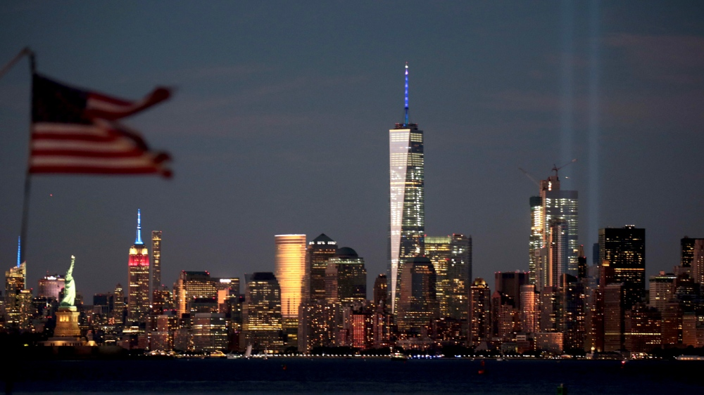 Manhattan is framed by the flag of a passing boat on the eve of the 15th Anniversary of the September 11 attacks.