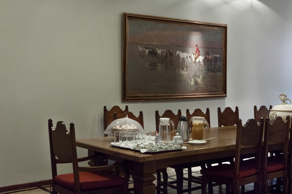 A dining room at Mr. Mario Franco, one of the most traditional cattle breeders of the country. Mr Mario Franco, whose name noums the airport of the city, was one of the first farmers to bring cattle from India. A very social and politic man whose farm was frequented by international and national personalities, as Mr Bush (father), Margaret Tatcher and many Brazilian politics. One very known was the right ring candidate who lost elections in 2014, Aécio Neves.  Uberaba, Minas Gerais, Brazil, 2014