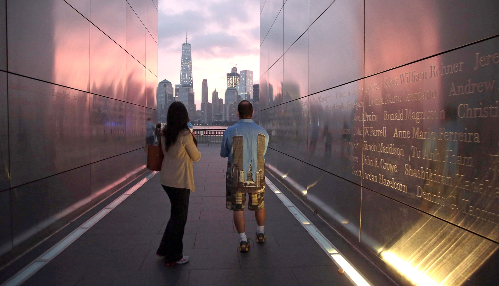 Steven Monetti Jr. and his fiancee Michelle Johnson walks through the Empty Sky Memorial in Jersey City on the morning of the 15th Anniversary of the September 11 attacks.