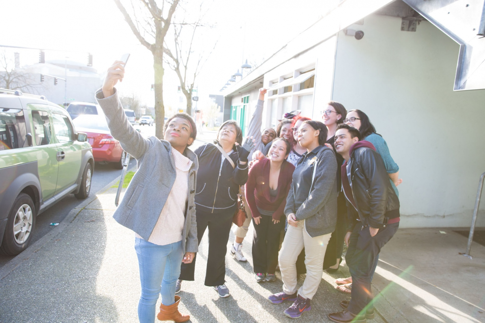 Marcelas takes a selfie with members of Washington Community Action Network. Marcelas work with the network led to a White House invitation and a fist-bump from Obama.  For CNN Digital