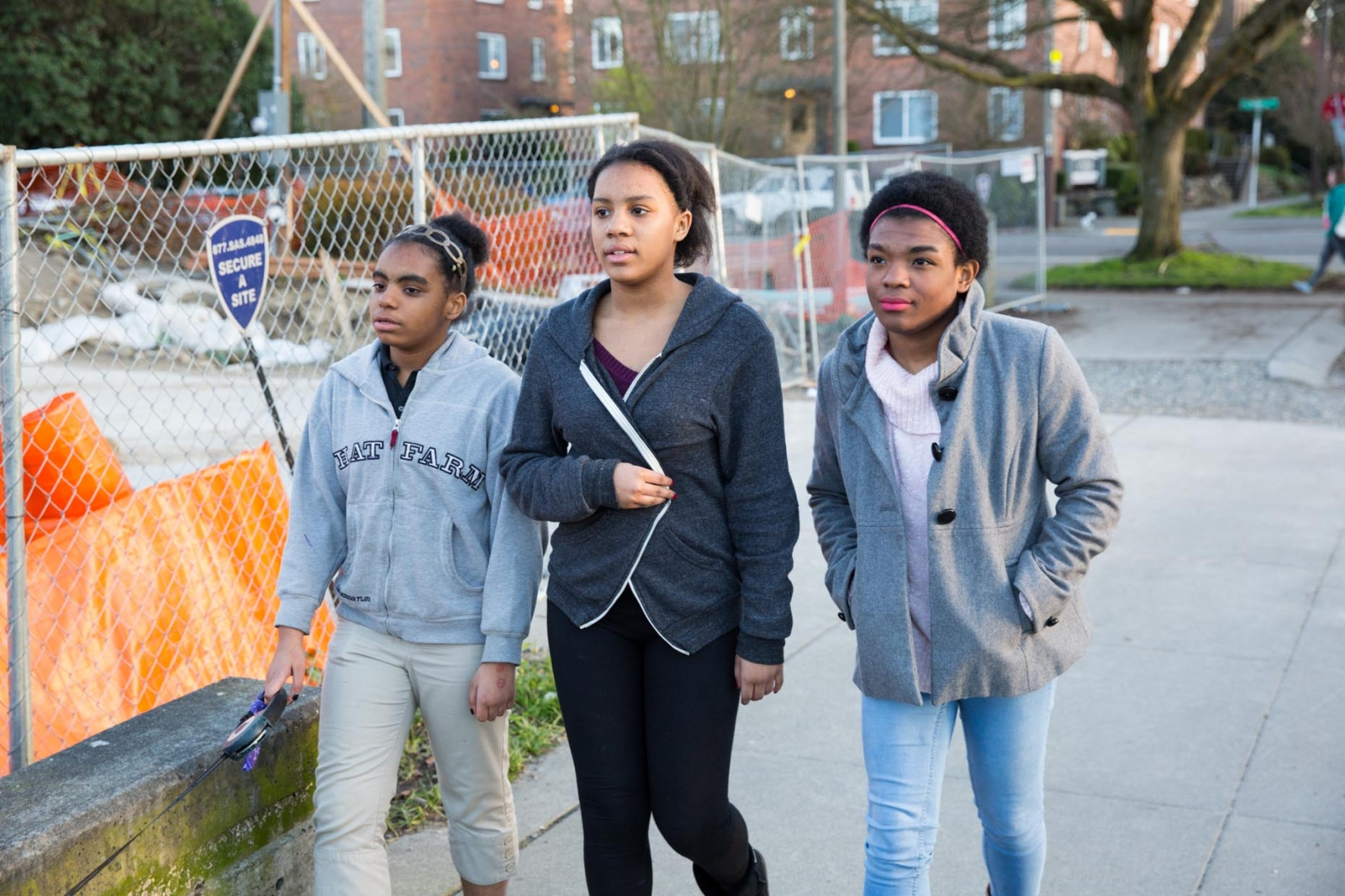 Marcelas takes a walk with her sisters Myanna, 12, left and Monique, 13 near their home.  For CNN Digital