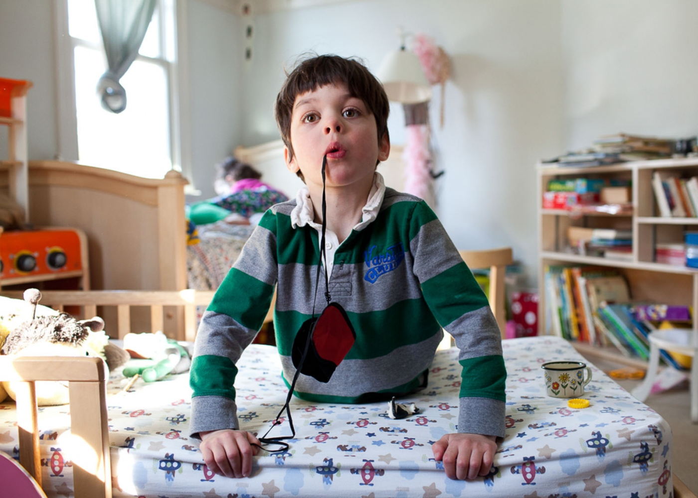 Finn plays in his sister Annabel's bedroom.  For Money Magazine