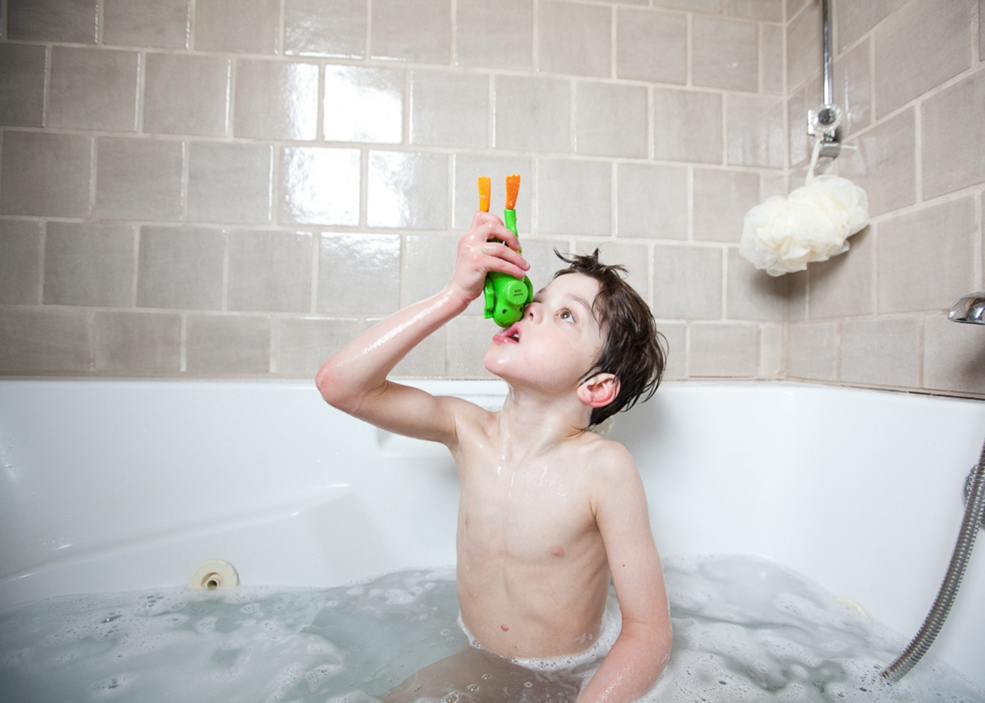 Finn loves playing in the bathtub. It is often a struggle to get him out.  For Money Magazine