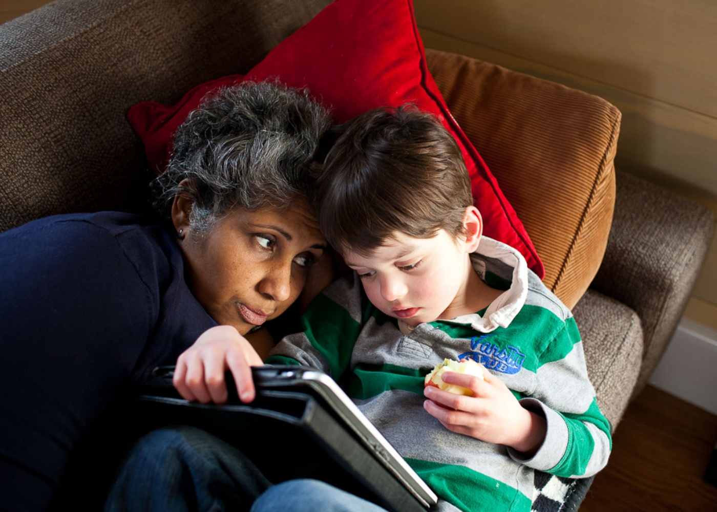 Finn plays on the iPad with his beloved nanny Gee.  For Money Magazine