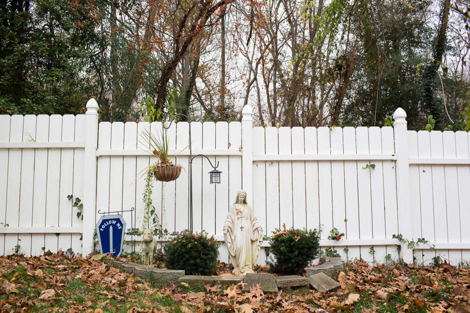 In the Kochs backyard, next to a statue of Mary, is a memorial to the family dog Keiser, Lynnes favorite. The blue sign is a symbol of the infantry. For CNN Digital