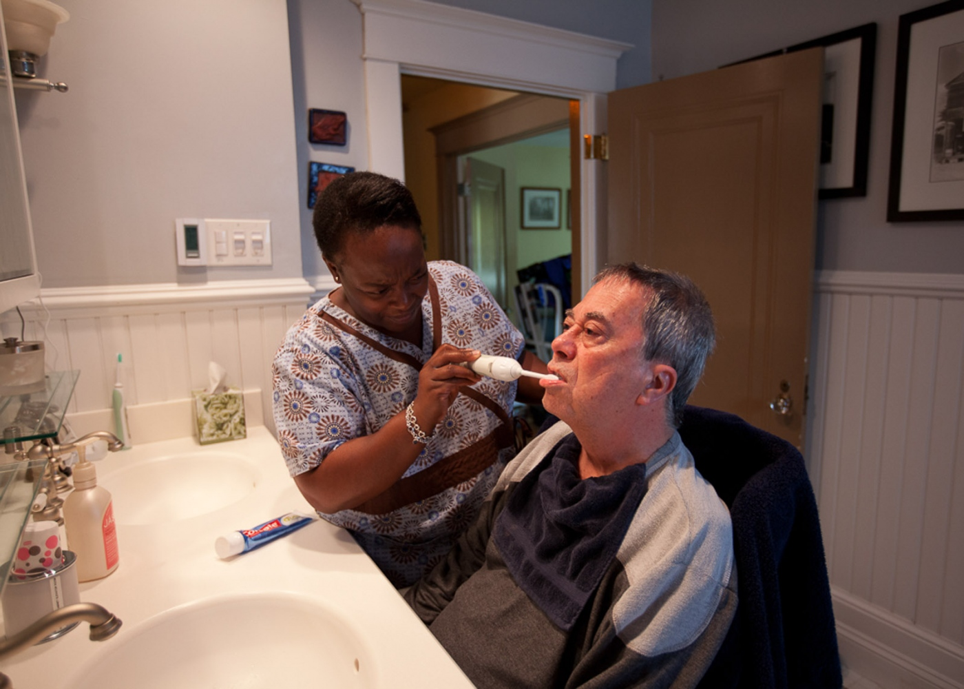 A home health aide comes 4 hours per day to help get Steve ready, a routine that includes bathing him, brushing his teeth, getting him dressed and physical therapy. For Money Magazine