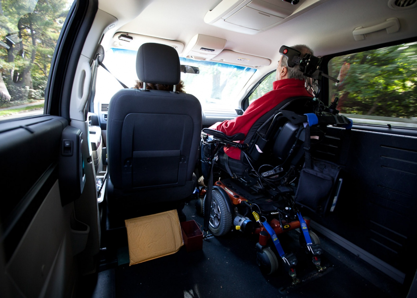 Pam drives Steve in a minivan that has been custom fit to transport his wheelchair. For Money Magazine